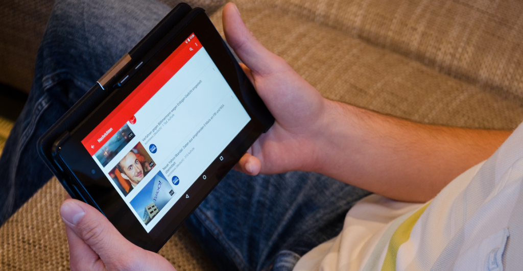 Man watch Tablet Youtube