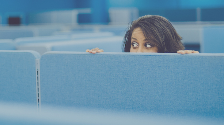 Office worker eavesdropping in cubicle room